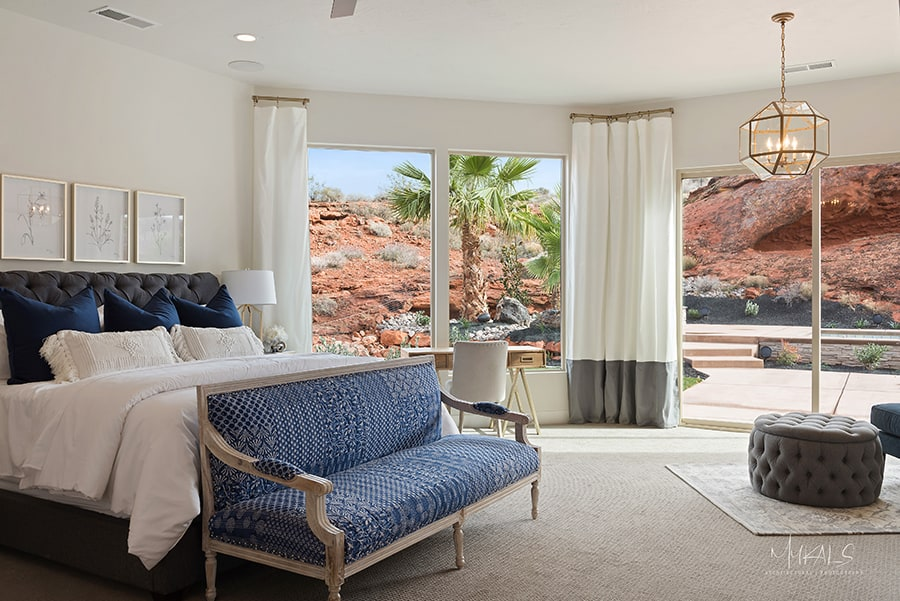 Bedroom With Large Glass Patio Door Overlooking St. George Utah Landscape