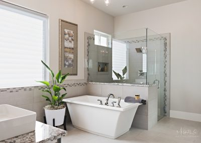 Large beautiful bathroom with soaking tub and frameless glass shower by jones paint and glass store