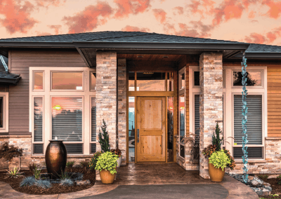 Fortified Fir Exterior Front Door of Beautiful Home at Sunset