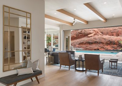 Multi-slide doors open to reveal pool from living room in beautiful home